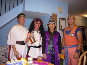 2009:  Jack-sparrow inspired pirate.  Notice my mom's costume.  She made that by hand!  Ricky on the right is also very crafty with a sewing machine